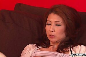Asian milf has a sex toy session with her pussy